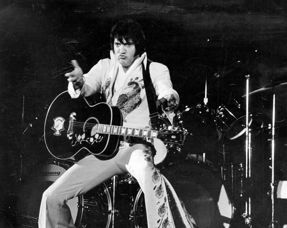 Elvis Presley performs in a 1974 San Antonio show. Photo: San Antonio Express-News /File Photo / San Antonio Express-News