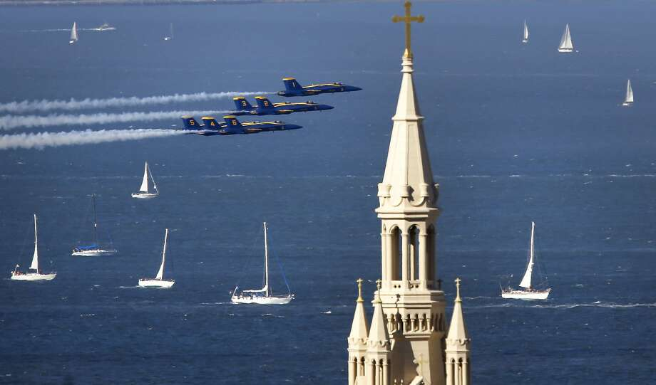 The Navy Blue Angels fly past the steeple of St. Peter and Paul Church as they take to the skies over San Francisco Bay during Fleet Week in San Francisco , Calif., on Sat. October 10, 2015. Photo: Michael Macor, The Chronicle