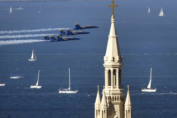 The Navy Blue Angels fly past the steeple of St. Peter and Paul Church as they take to the skies over San Francisco Bay during Fleet Week in San Francisco , Calif., on Sat. October 10, 2015.