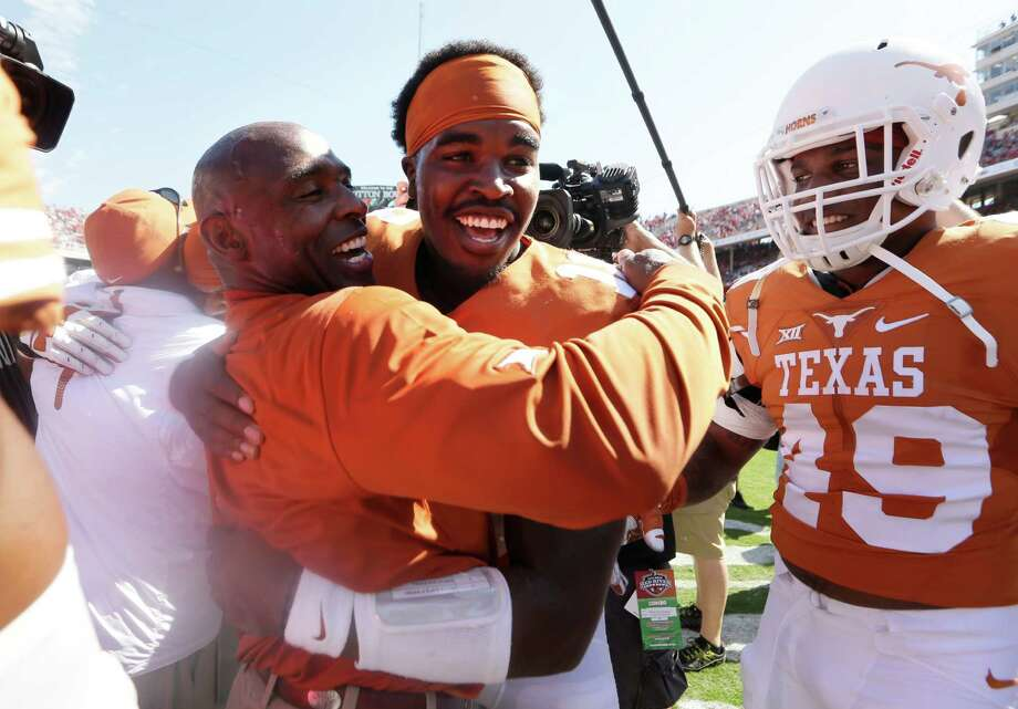 Two of UT's embattled figures - coach Charlie Strong, left, and quarterback Tyrone Swoopes - enjoy a  triumphant day in which Swoopes contributed touchdowns running and passing in spot duty. Photo: LM Otero, STF / AP