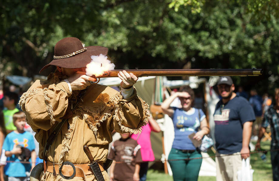 Ryan Badger, an Alamo living history staff member, shoots a Pennsylvania long rifle as part of a firing demonstration Saturday, Oct. 10, 2015, at Fall at the Alamo, an annual interactive living history event. Photo: Alma E. Hernandez /For The San Antonio Express-News
