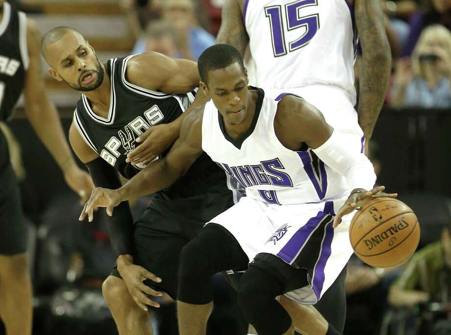 San Antonio Spurs guard Patty Mills, of Australia, left, stops the drive of Sacramento Kings guard Rajon Rondo during the first quarter of an NBA preseason basketball game in Sacramento, Calif., Thursday Oct. 8, 2015. The Kings won 95-92.(AP Photo/Rich Pedroncelli) Photo: Rich Pedroncelli, STF / Associated Press / AP