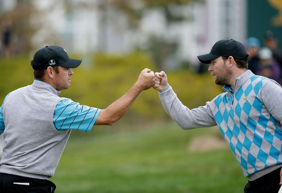 Branden Grace (left) and Louis Oosthuizen are 4-0 for the International Team. Photo: Chung Sung-Jun, Getty Images