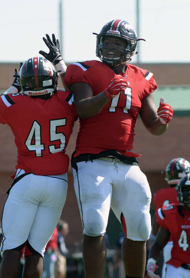 Westfield senior defensive lineman Ed Oliver (11) celebrates with teammate and sophomore linebacker Greg Green (45) after Green's block of a punt by Klein Collins senior Paul Purifoy late in the   2nd quarter of their District 15-6A matchup at Leonard George Stadium in Spring on Saturday, Oct. 10, 2015. (Photo by Jerry Baker/Freelance)4 Photo: Jerry Baker, For The Houston Chronicle