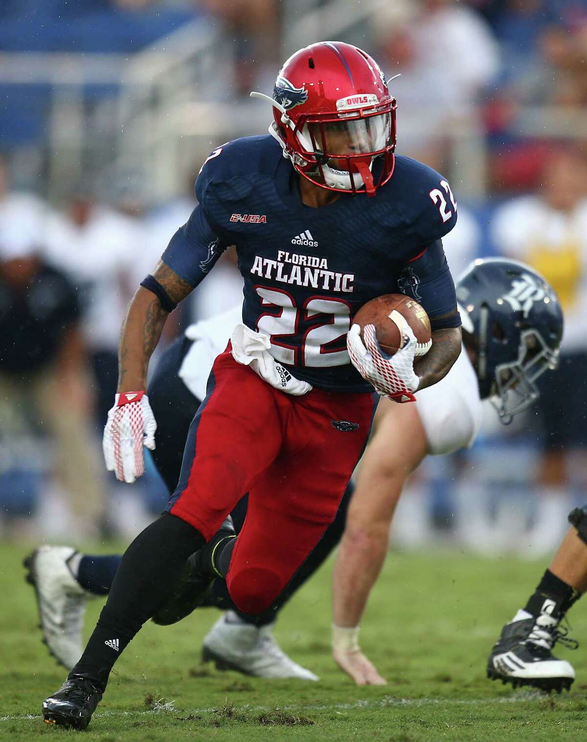 BOCA RATON, FL - OCTOBER 10: Trey Rodriguez #22 of the Florida Atlantic Owls rushes for a touchdown during the fourth quarter of the game against the Rice Owls at FAU Stadium on October 10, 2015 in Boca Raton, Florida.