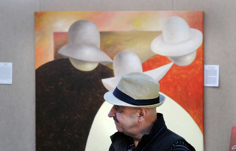 The New Mexican artist who goes by the name Guilloume stands in front of one of his paintings at the 34th annual Outdoor Arts Festival at the Bruce Museum in Greenwich on Saturday. The event features works by 85 artists from all over the country, along with live music, food trucks and family art activities. The festival continues Sunday, from 10 a.m. to 5 p.m., at the museum at 1 Museum Drive. Admission is $8. Photo: Bob Luckey Jr. / Hearst Connecticut Media / Greenwich Time