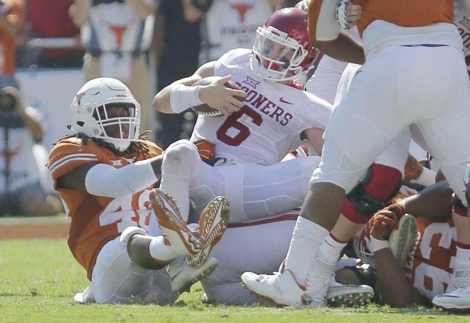 Texas linebacker Malik Jefferson (46) sacks Oklahoma quarteback Baker Mayfield (6) during the first half at the Cotton Bowl in Dallas on Saturday, Oct. 10, 2015. Texas won, 24-17. (Brandon Wade/Fort Worth Star-Telegram/TNS) Photo: Brandon Wade, STR / McClatchy-Tribune News Service / Fort Worth Star-Telegram