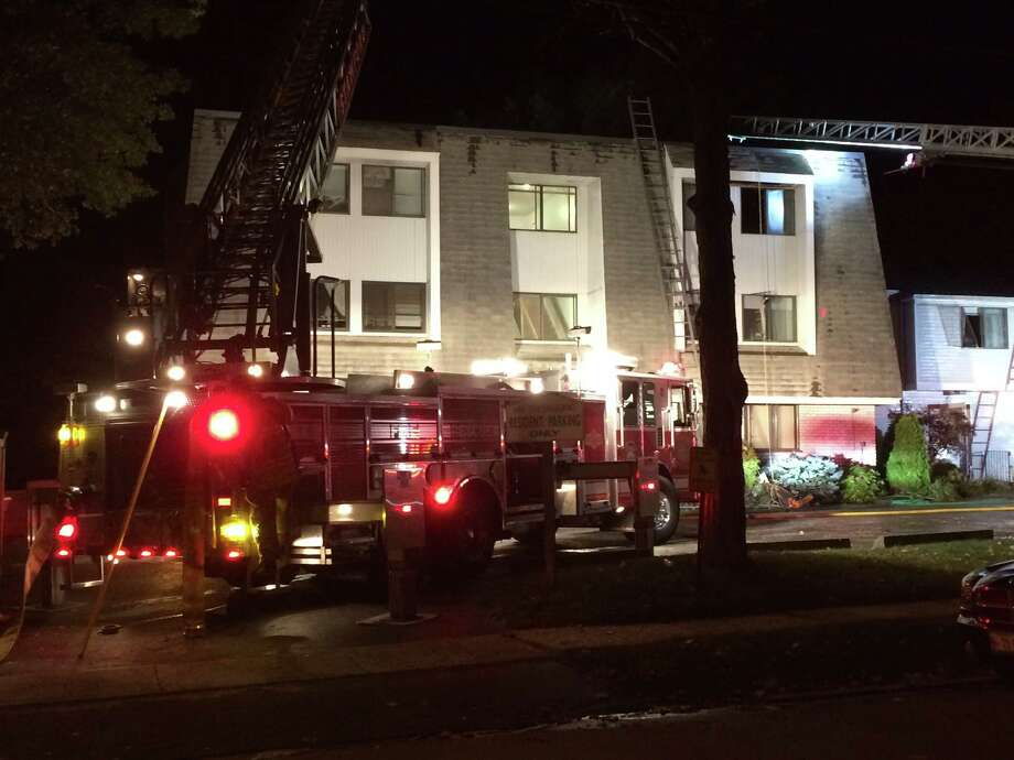 A fire ripped through parts of an apartment building at 71 Riverside Ave. in the Bullshead section of Stamford at about 7 p.m. Saturday, Oct. 10. Photo: Christine Hall / Hearst Connecticut Media / Stamford Advocate