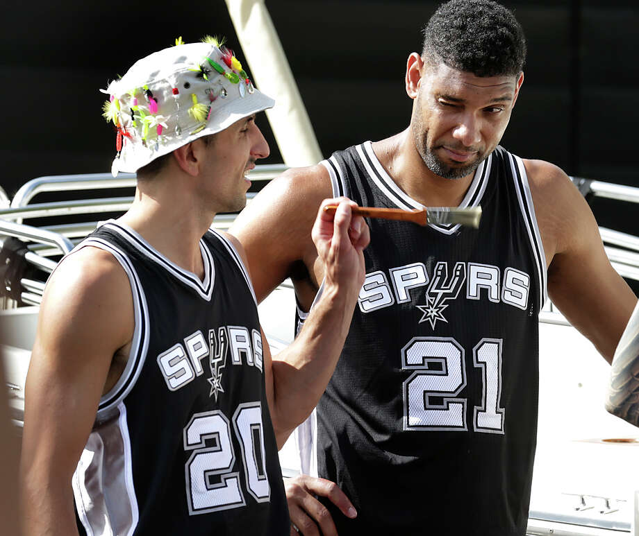 Tim Duncan reacts to Manu Ginobili as he pretends to apply makeup on Duncan as the San Antonio Spurs spent much of the afternoon at their practice facility performing for new HEB commercials on Tuesday, October 6, 2015, that will be aired during the upcoming season. Photo: Bob Owen, Staff / San Antonio Express-News / ©2015 San Antonio Express-News