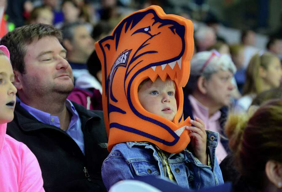 Austin Wolf, 3, of Fairfield, proudly wears his Sound Tigers foam novelty hat as he sits with his dad Greg during AHL hockey action against the Wilkes-Barre/Scranton Penguins at the Webster Bank Arena in Bridgeport, Conn. on Saturday October 10, 2015. On Tuesday, Oct. 13 the Sound Tigers face Springfield at home at 7 p.m. Photo: Christian Abraham, Hearst Connecticut Media / Connecticut Post
