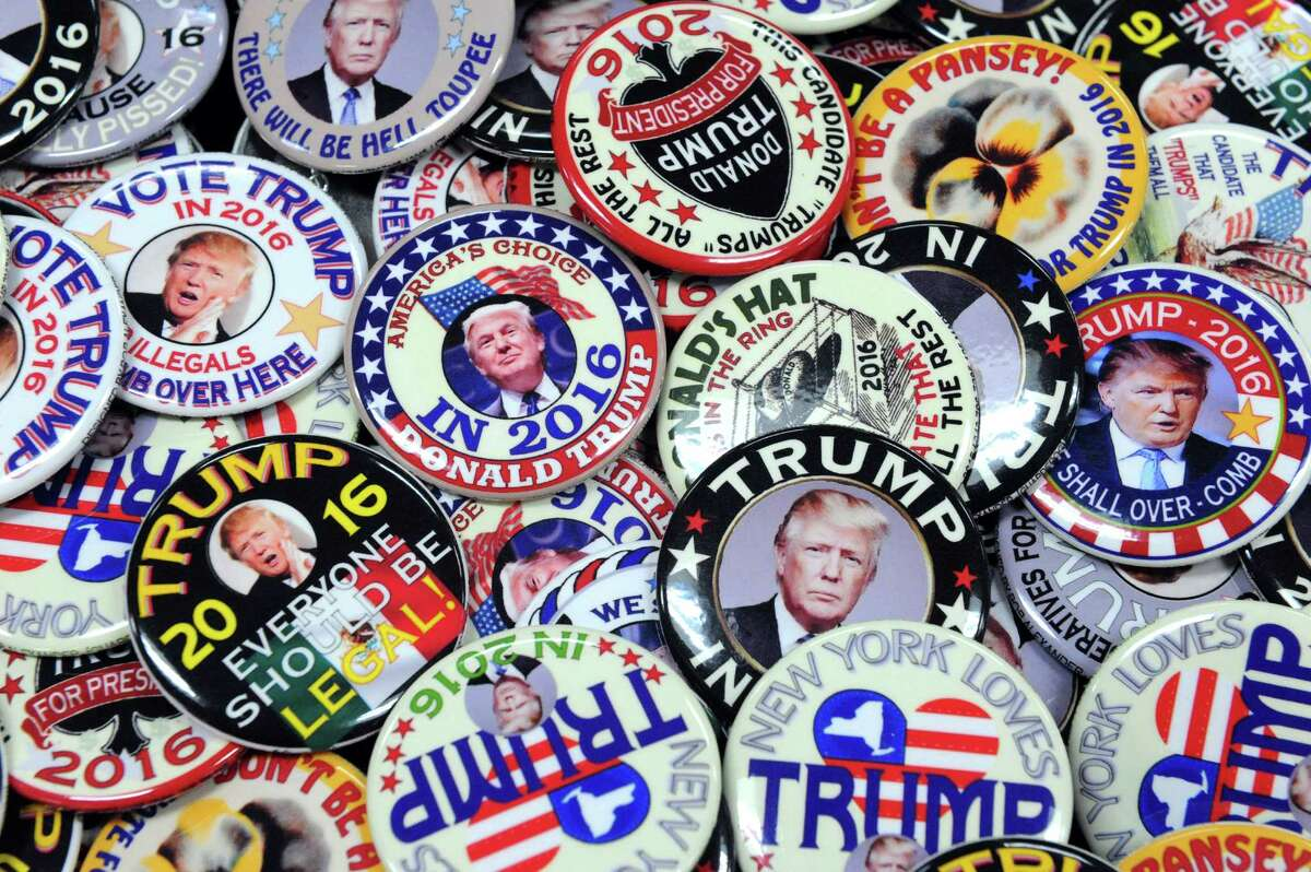 Trump pins designed by Guard Frog for sale during the american political items collectors show at the Ramada Plaza on Saturday Oct. 10, 2015 in Albany, N.Y. (Michael P. Farrell/Times Union)