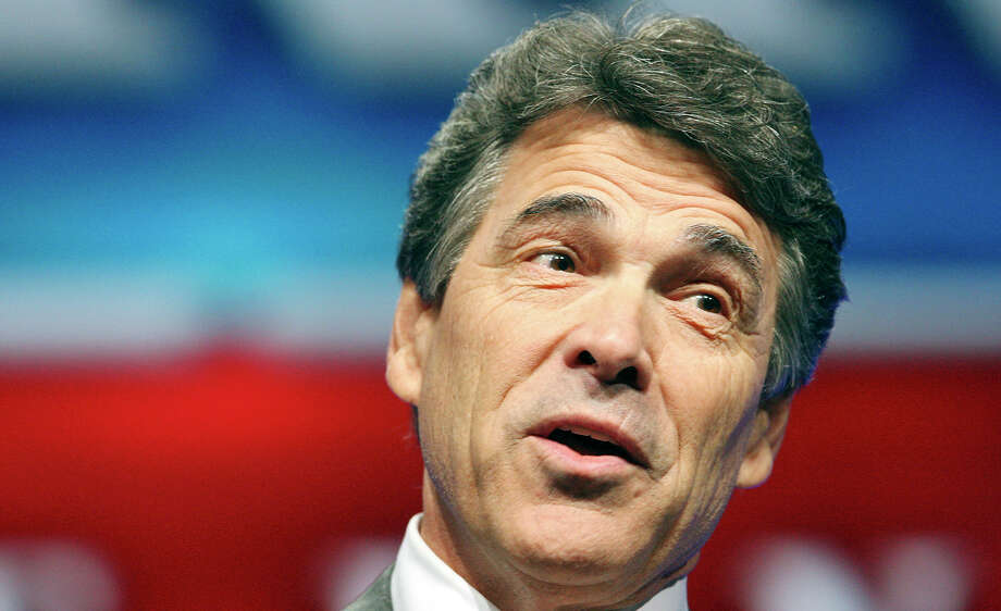 Former Gov. Rick Perry doled out tens of thousands of dollars in bonuses for top aides in his final weeks in office. Photo: Edward A. Ornelas, Staff / © 2012 San Antonio Express-News
