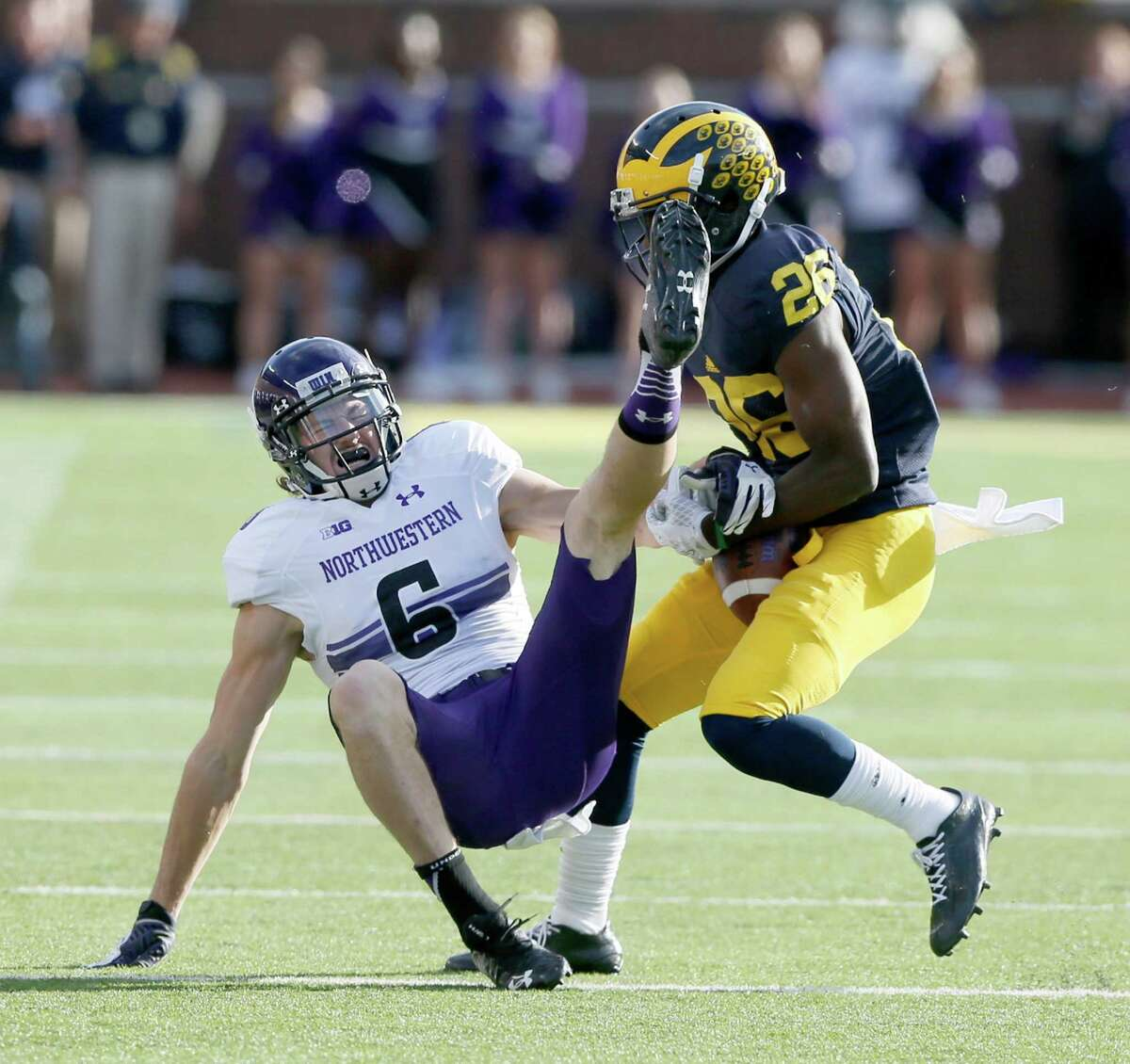 Michigan's Jourdan Lewis, right, breaks up a pass to Northwestern's Mike McHugh, leading to an interception and a 37-yard touchdown return by Lewis in the first half on Saturday, Oct. 10, 2015, at Michigan Stadium in Ann Arbor, Mich. (Julian H. Gonzalez/Detroit Free Press/TNS)