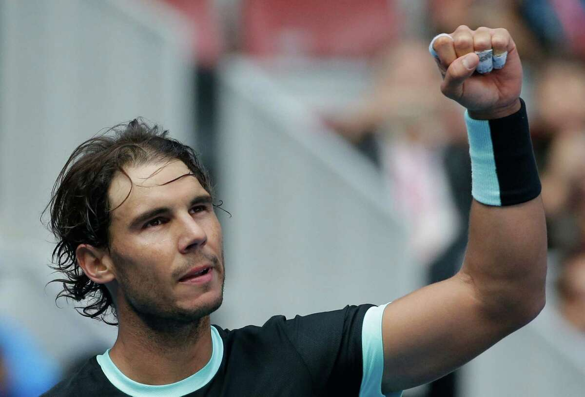 Rafael Nadal of Spain celebrates after defeating Fabio Fognini of Italy in the men's singles semifinals match of the China Open tennis tournament at the National Tennis Stadium in Beijing, Saturday, Oct. 10, 2015. (AP Photo/Andy Wong) ORG XMIT: XAW103
