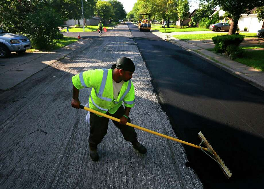 Public Works director Dale Rudick estimated Houston would have to spend roughly $650 million annually on road work, such as the  resurfacing work on Baneway Drive near Beechnut Street, to keep the city's streets and drainage system in good repair. Photo: Mark Mulligan, Staff / © 2015 Houston Chronicle