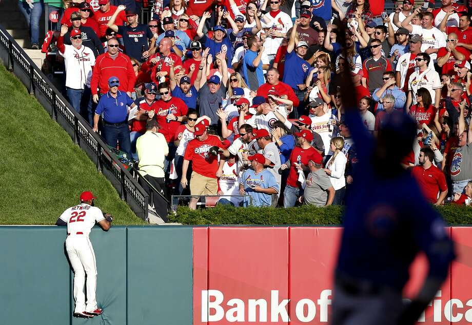 St. Louis' Jason Heyward can't get to the home run ball hit by Chicago's Jorge Soler in the second inning. The homer scored Dexter Fowler, who is in silhouette as he circles the bases. Photo: Charles Rex Arbogast, Associated Press