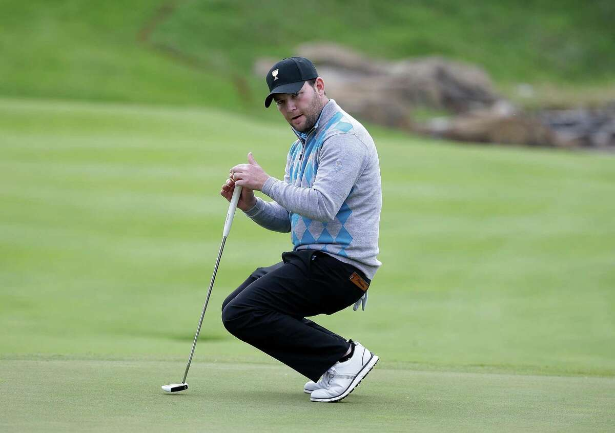 INCHEON CITY, SOUTH KOREA - OCTOBER 10: Branden Grace of South Africa and the International Team reacts after a putt on the 5th hole during the Saturday four-ball matches at The Presidents Cup at Jack Nicklaus Golf Club Korea on October 10, 2015 in Songdo IBD, Incheon City, South Korea. (Photo by Chung Sung-Jun/Getty Images) ORG XMIT: 580241143