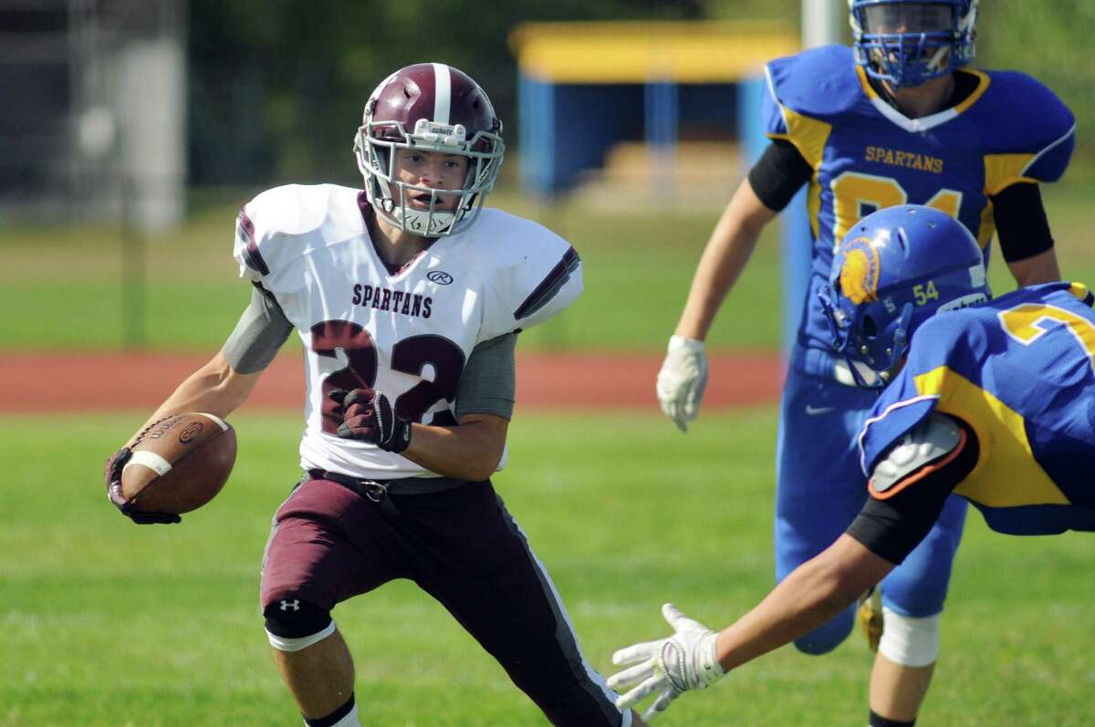 Burnt Hills' Michael Leveroni, left, veers away from Queensbury's Jared Bruno's oncoming tackle during their football game on Saturday, Sept. 26, 2015, at Queensbury High in Queensbury, N.Y. (Cindy Schultz / Times Union)