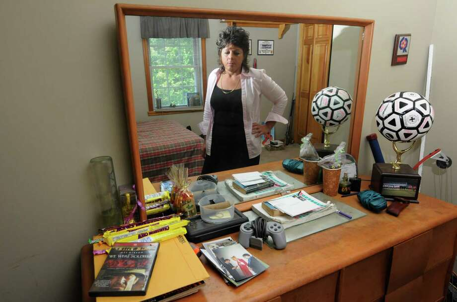 Veronica Frear , mother of a Craig Frear, a Scotia High School  soccer player who disappeared, stands in his room in this Tuesday Aug, 2, 2011, file photo. ( Michael P. Farrell/Times Union) Photo: Michael P. Farrell / 00014115A