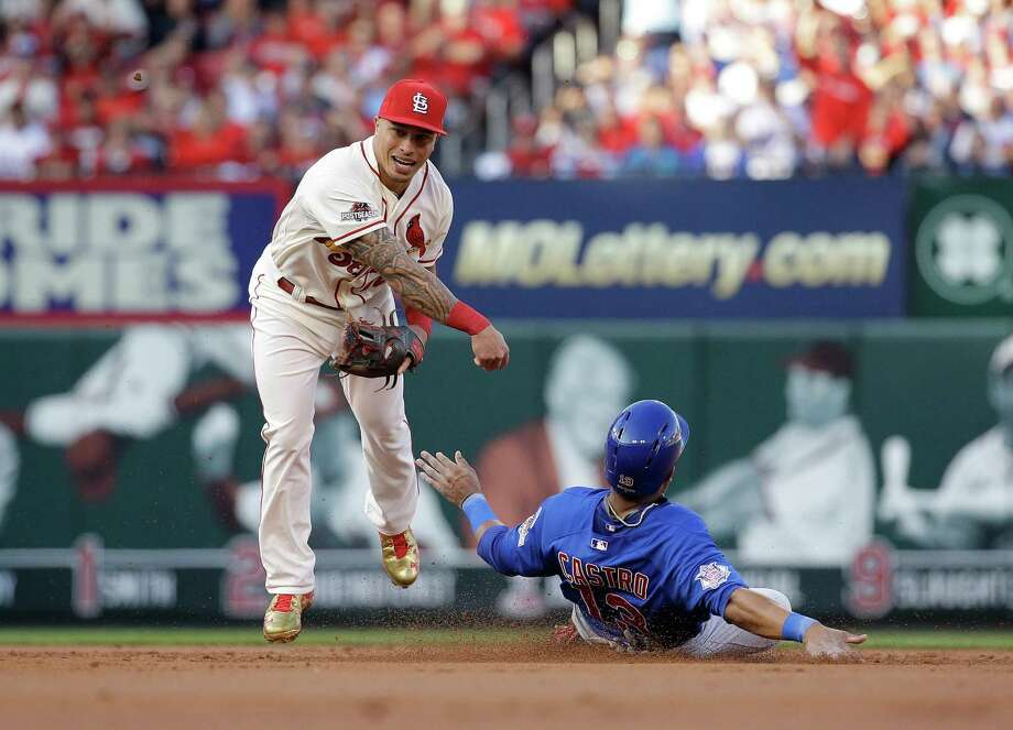 The Cubs' Starlin Castro is forced out, but  Cards second baseman Kolten Wong's relay to first was errant, allowing Austin Jackson to reach second. Photo: Jeff Roberson, STF / AP