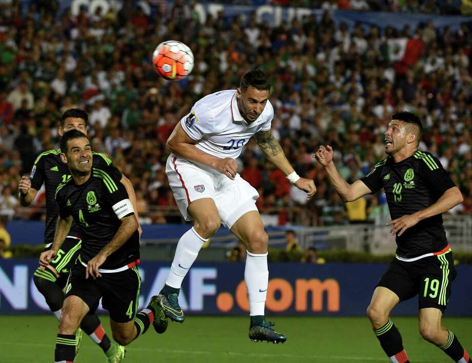 Former Dynamo player Geoff Cameron of the U.S. heads the ball for a goal in the 15th minute against Mexico to temporarily tie the match. Photo: MARK RALSTON, Staff / AFP