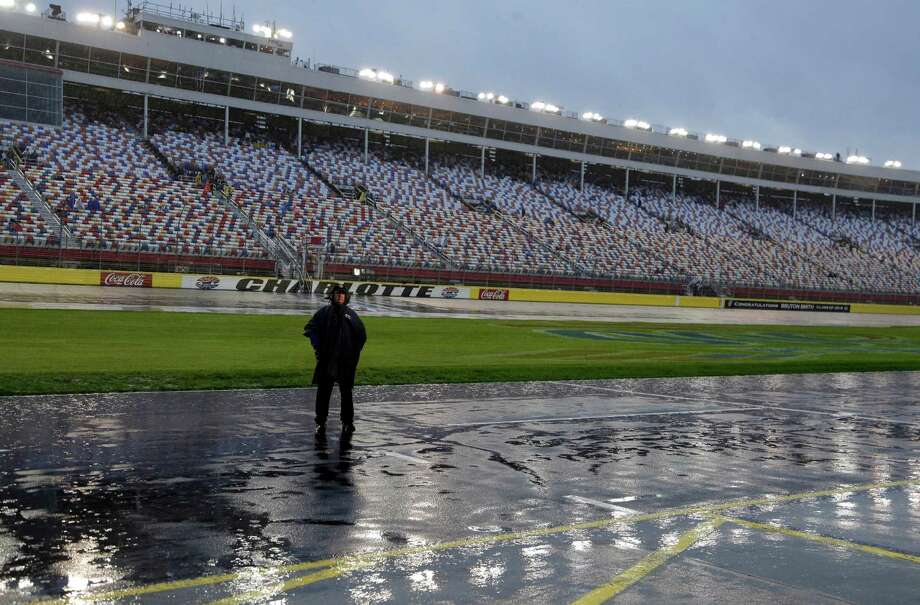 Saturday night's Sprint Cup race was postponed until Sunday after rain took its toll on the track at Charlotte Motor Speedway in Concord, N.C. Photo: Chuck Burton, STF / AP