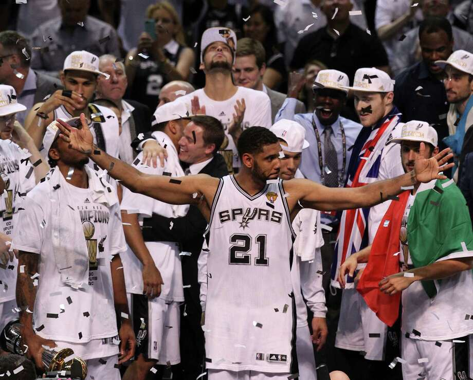 San Antonio Spurs' Tim Duncan acknowledges the fans after winning Game 5 against the Miami Heat at the 2014 NBA Finals at the AT&T Center on Sunday, June 15, 2014. (Kin Man Hui/San Antonio Express-News) Photo: Kin Man Hui, Staff / San Antonio Express-News / ©2014 San Antonio Express-News