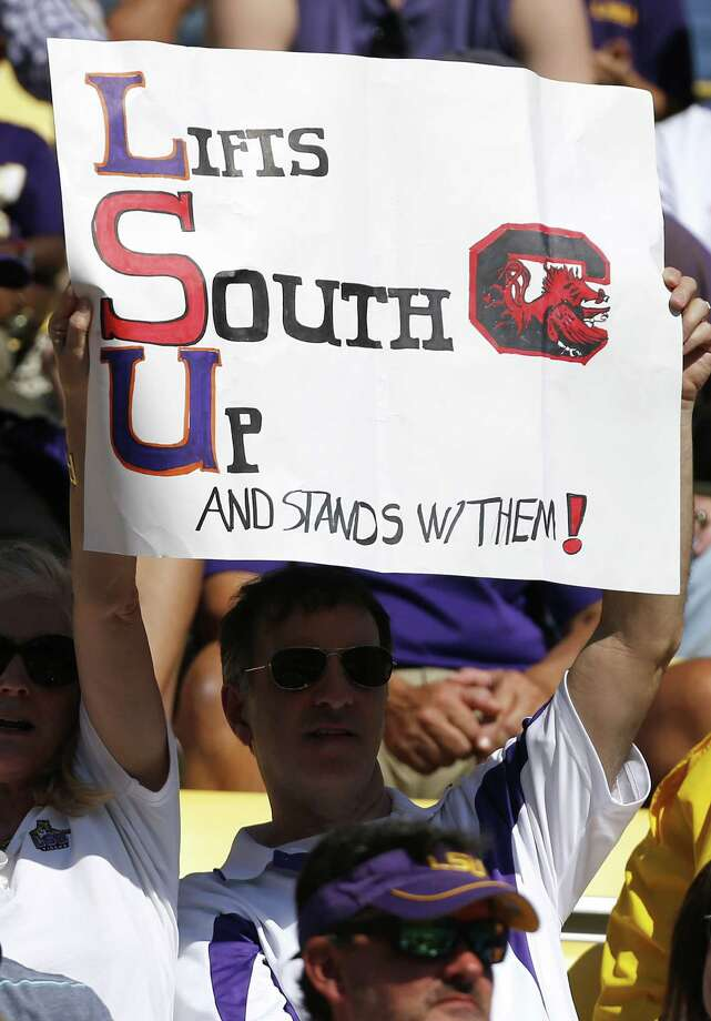 """LSU fans showed their support for South Carolina while still rooting for the """"visiting"""" Tigers. Photo: Jonathan Bachman, FRE / FR170615 AP"""