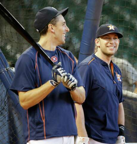 With his recent struggles at the plate, Jason Castro, left, may seem a liability to Jed Lowrie and the Astros during the playoffs. But the catcher has more than made up for it with his defensive prowess. Photo: Melissa Phillip, Staff / © 2015 Houston Chronicle
