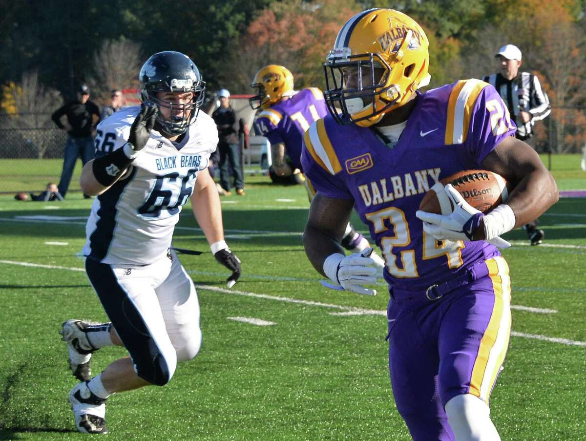UAlbany's #24 Elijah Ibitokun-Hanks, right, runs the ball as Maine defender #66 Schuyler Huntington closes in during Saturday's game at Casey Stadium Oct. 10, 2015 in Albany, NY. (John Carl D'Annibale / Times Union)
