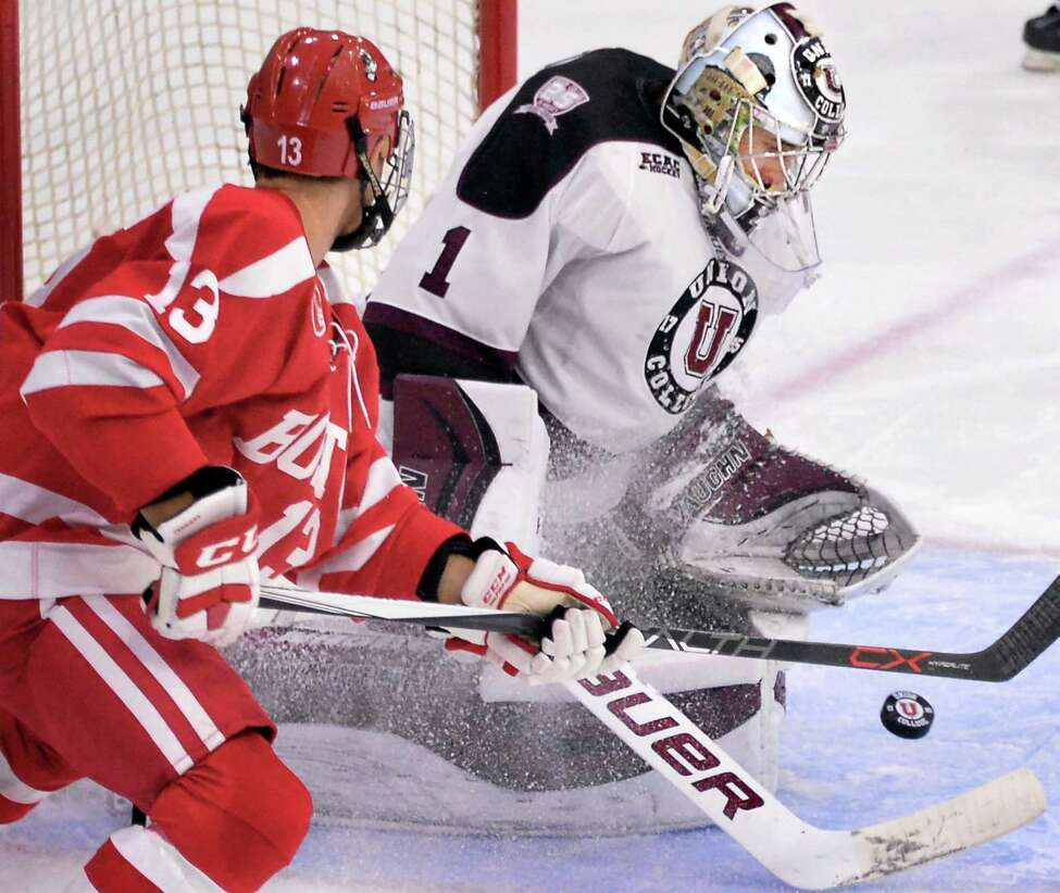 Union goalie Alex Sakellaropoulos stops a shot by Boston University's #13 Nikolas Olsson, left, during Saturday's game at Messa Rink Oct. 10, 2015 in Schenectady, NY. (John Carl D'Annibale / Times Union)