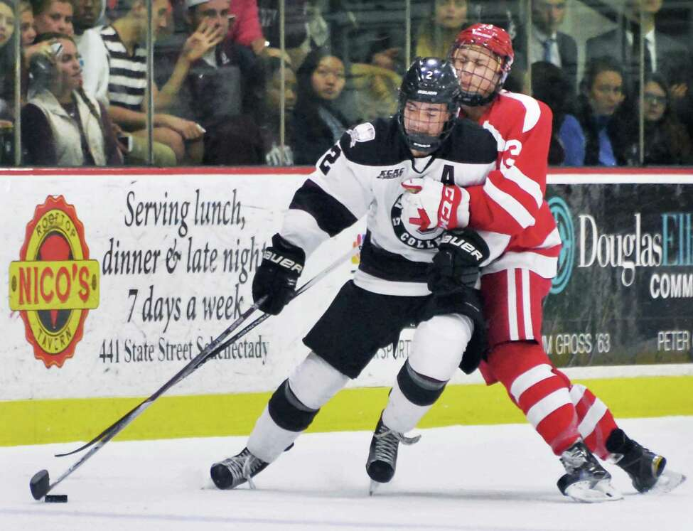 Union's #2 Jeff Taylor, left, tangles with Boston University's #13 Nikolas Olsson during Saturday's game at Messa Rink Oct. 10, 2015 in Schenectady, NY. (John Carl D'Annibale / Times Union)