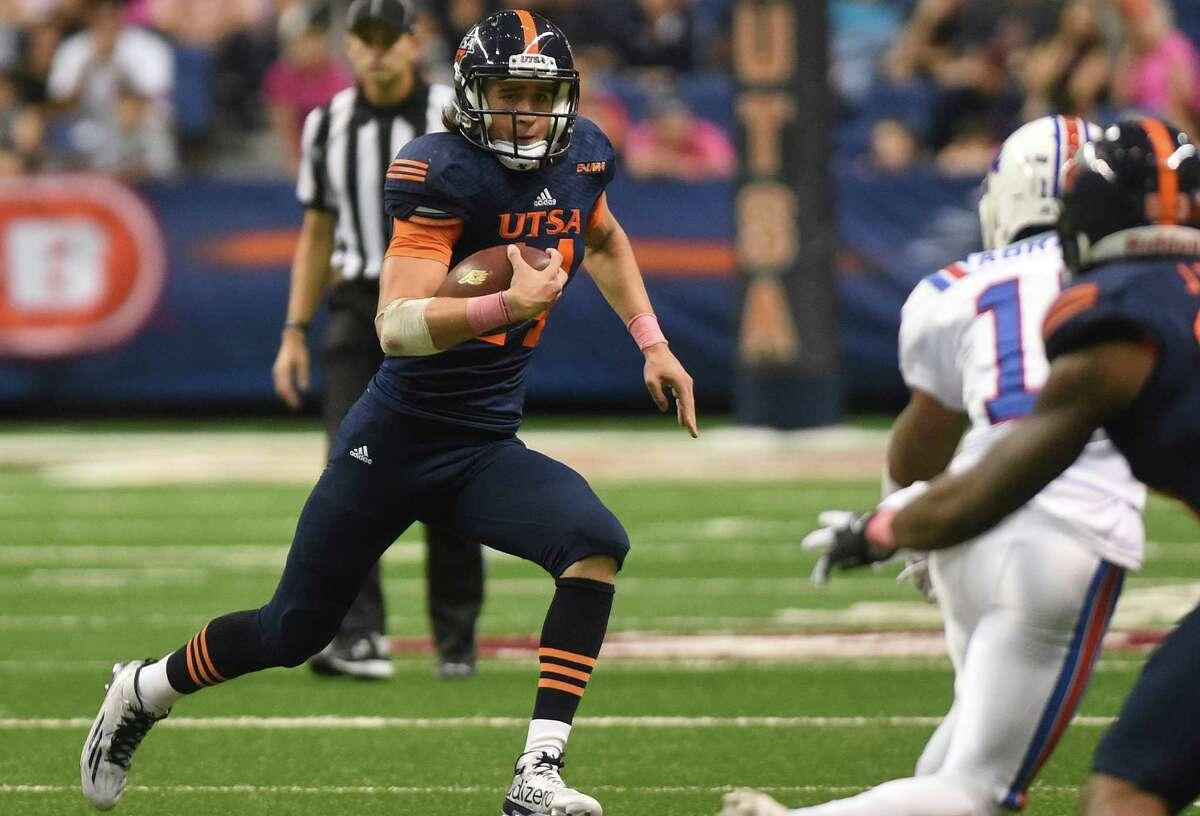 UTSA quarterback Dalton Sturm runs for yardage during the second half against Louisiana Tech in the Alamodome on Oct. 10, 2015.