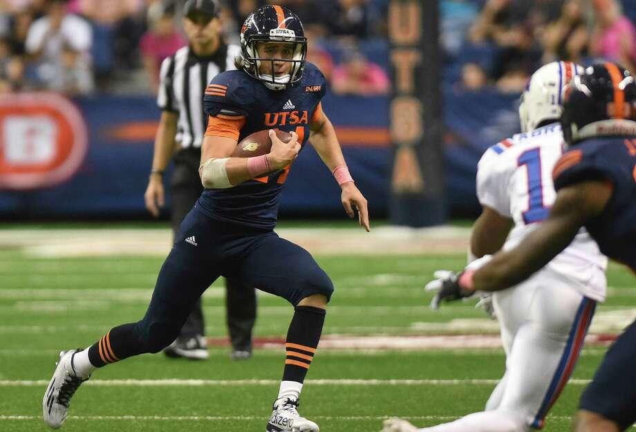 UTSA quarterback Dalton Sturm runs for yardage during the second half against Louisiana Tech in the Alamodome on Oct. 10, 2015. Photo: Billy Calzada /San Antonio Express-News / San Antonio Express-News