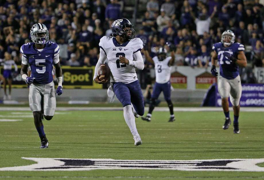 TCU quarterback Trevone Boykin outraces Kansas State defenders on a 69-yard touchdown run in the fourth quarter. Boykin accounted for 425 yards of total offense and four TDs. Photo: Paul Moseley /McClatchy-Tribune News Service / Fort Worth Star-Telegram