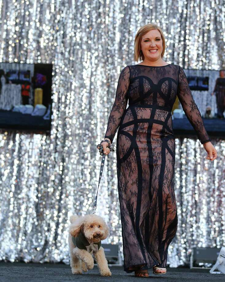 Rebecca West models a dress as she walks her dog, Buddy, a rescued poodle down the runway during the inaugural Glamour Dogs: Rip the Runway dog clothing fashion show on  Saturday, Oct. 10, 2015, in Houston. The show showcased all the latest trends, including the practical, fashionable, and hilarious. Photo: Elizabeth Conley, Houston Chronicle / © 2015 Houston Chronicle