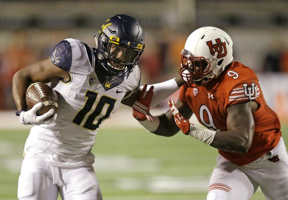 California wide receiver Darius Powe (10) carries the ball as Utah defensive back Tevin Carter (9) closes in for a tackle in the first half during an NCAA college football game Saturday, Oct. 10, 2015, in Salt Lake City. (AP Photo/Rick Bowmer) Photo: Rick Bowmer, Associated Press