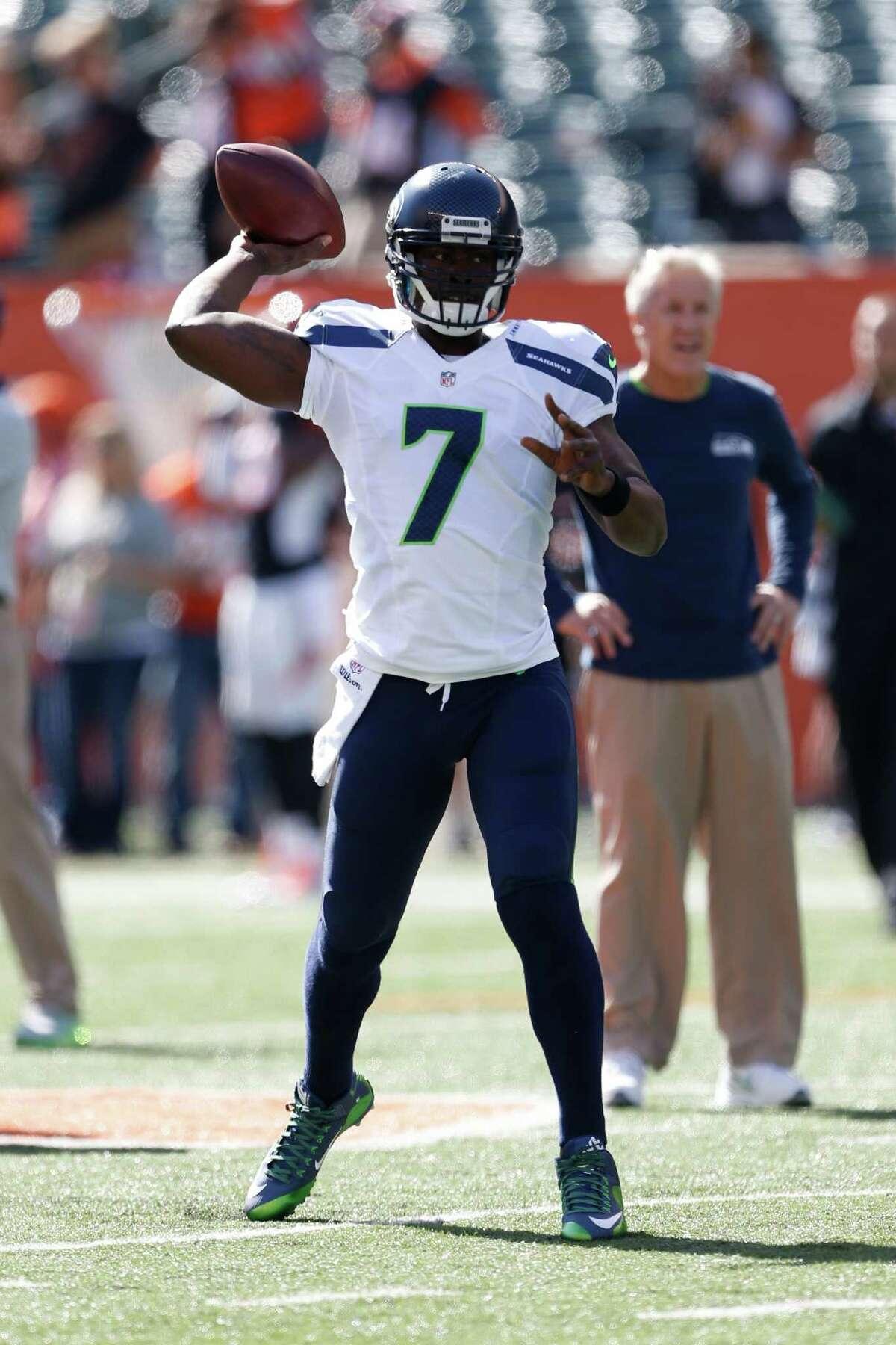 Seattle Seahawks quarterback Tarvaris Jackson throws during practice before an NFL football game against the Cincinnati Bengals, Sunday, Oct. 11, 2015, in Cincinnati. (AP Photo/Gary Landers)