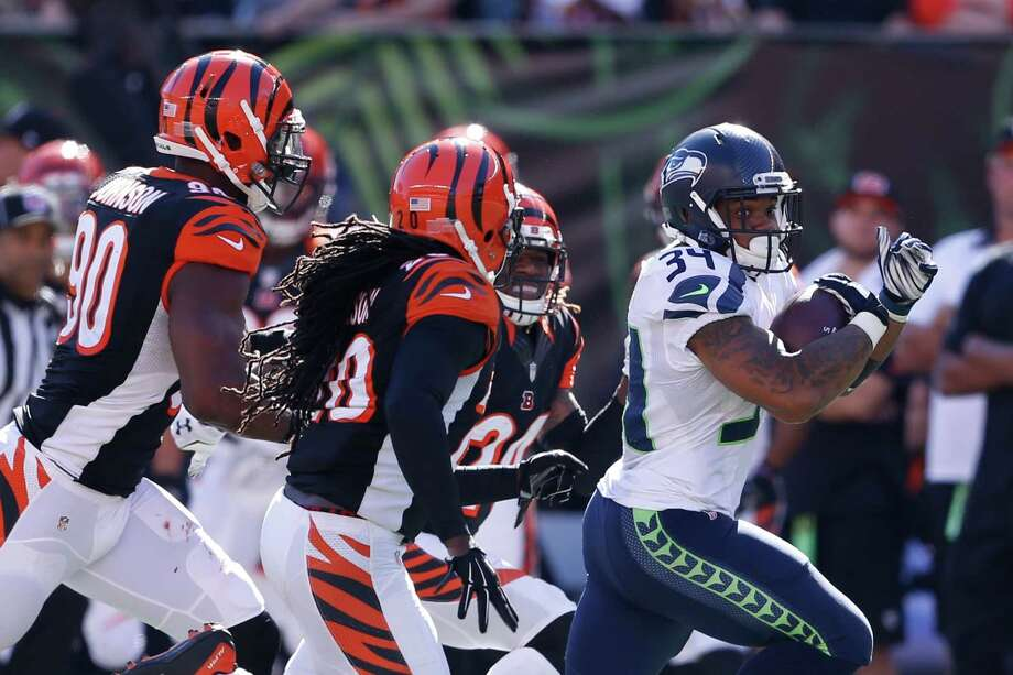 Seattle Seahawks running back Thomas Rawls (34) runs for a touchdown in the second half of an NFL football game against the Cincinnati Bengals, Sunday, Oct. 11, 2015, in Cincinnati. (AP Photo/Gary Landers) / FR171284 AP