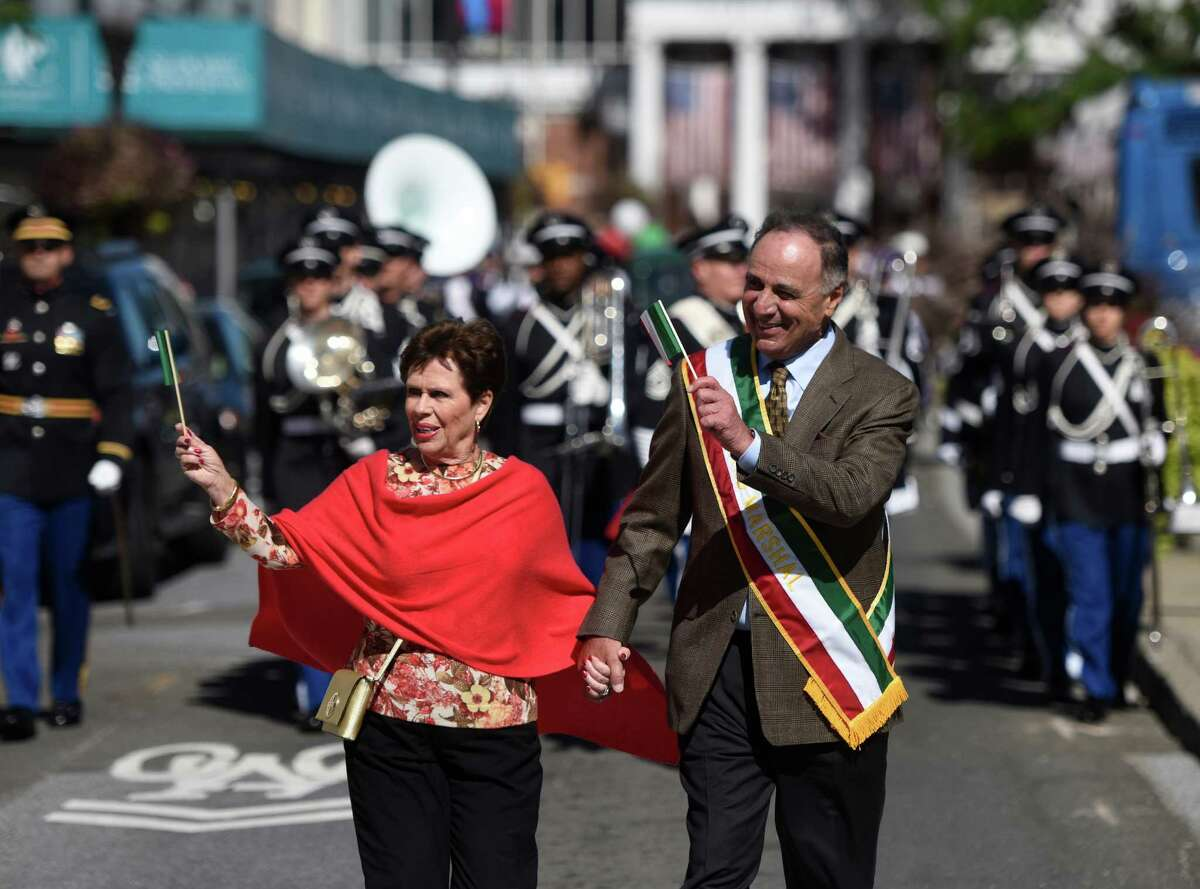 Grand Marshal Genaro Rubino, the Stamford 2014 Citizen of the Year, leads the way with his wife, Day Rubino, in the annual Columbus Day parade in Stamford, Conn. Sunday, Oct. 11, 2015. The event paid tribute to Christopher Columbus and other great Italian explorers with a variety of bands, floats and local organizations marching.
