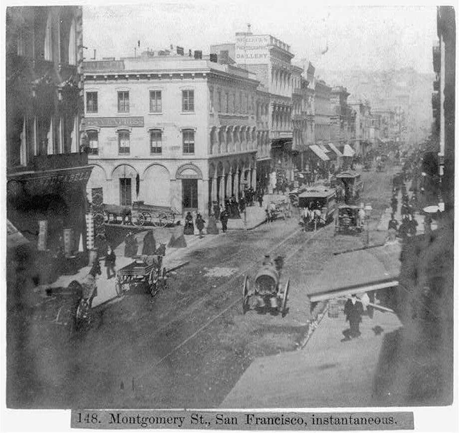 Horse-drawn carriages (and a horse-drawn streetcar) travel down Montgomery St. in the 1860s. Photo: Library Of Congress/Courtesy