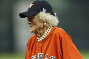 Former First Lady Barbara Bush stands on the field before the ceremonial first pitch, thrown by her husband, former President George H.W. Bush, before Game 3 of the American League Division Series against the Kansas City Royals at Minute Maid Park on Sunday, Oct. 11, 2015, in Houston. ( Karen Warren / Houston Chronicle )