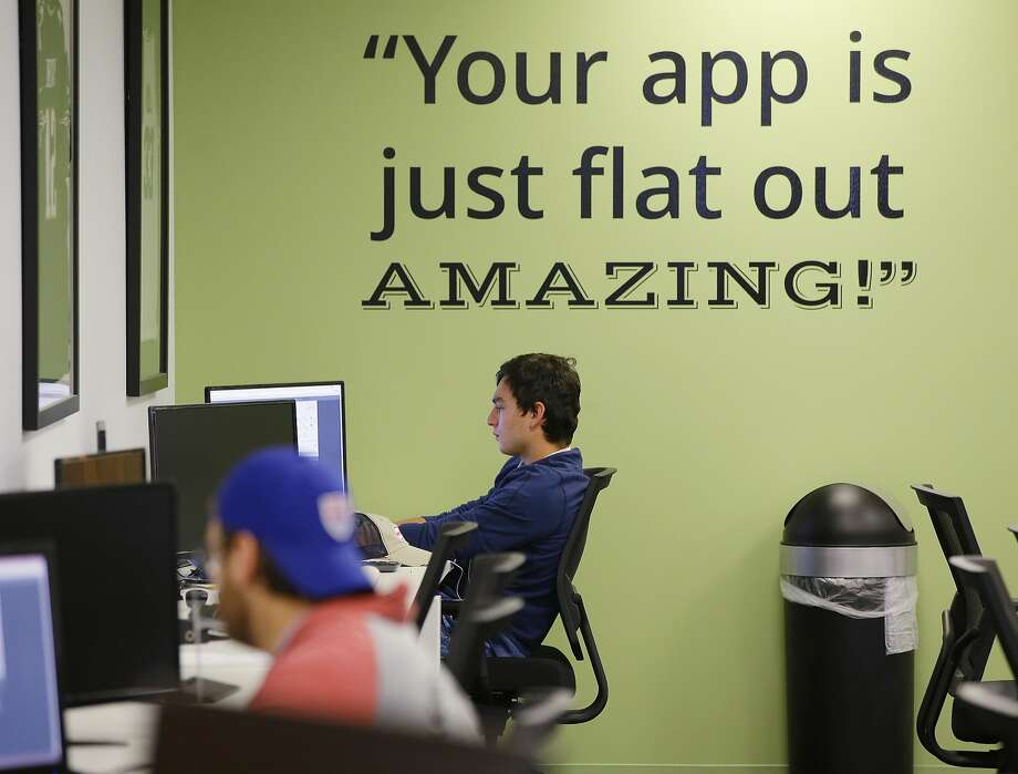 A customer service representative at DraftKings works at the company's offices in Boston in September 2015. Photo: Stephan Savoia, Associated Press