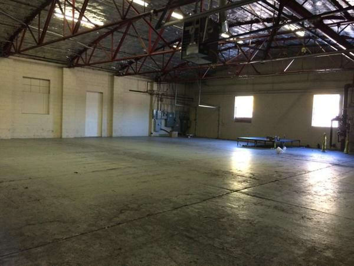 The inside of a warehouse at 20 Railroad Ave., Colonie, where police said they had to disperse hundreds of University at Albany students Oct. 10, 2015 who had attended an unsanctioned party. (Lauren Stanforth)