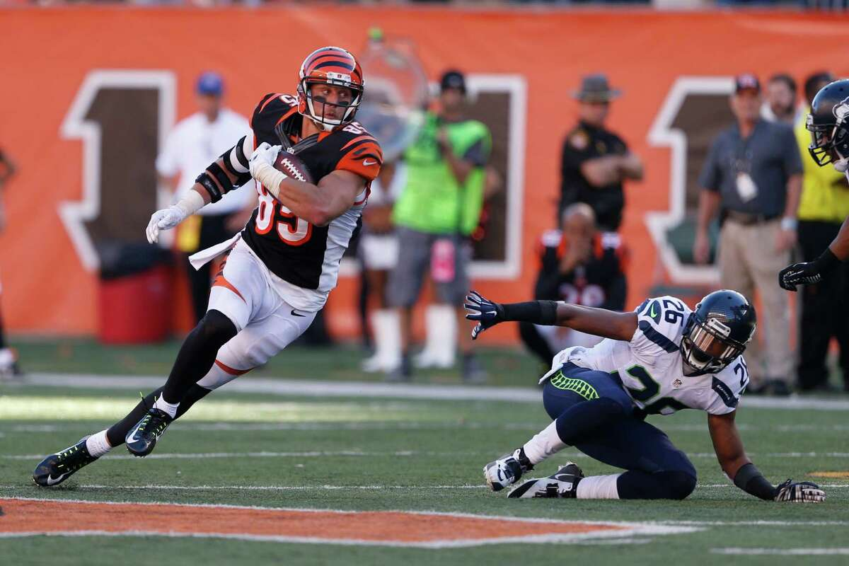 Cincinnati Bengals tight end Tyler Eifert (85) runs the ball in overtime of an NFL football game against the Seattle Seahawks, Sunday, Oct. 11, 2015, in Cincinnati. The Bengals won 27-24. (AP Photo/Gary Landers)