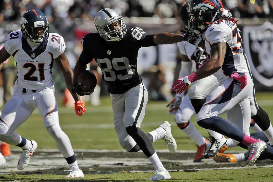 Amari Cooper (89) stiff arms David Bruton Jr. (30) in the second quarter for a 38-yard completion. The Oakland Raiders played the Denver Broncos at O.Co Coliseum in Oakland, Calif., on Sunday, October 11, 2015. Photo: Carlos Avila Gonzalez, The Chronicle