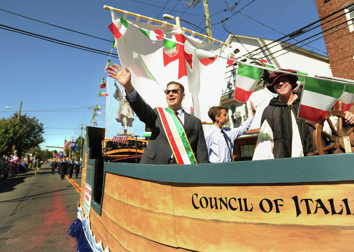 Bridgeport Deputy Chief of Police James Nardozzi, left, waves to the crowd as grand marshall of the 2015 Columbus Day Parade on Madison Avenue in Bridgeport, Conn. on Sunday, October 11, 2015.