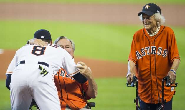 Former President George H.W. Bush embraces Astros third baseman Jed Lowrie (8) after throwing out the ceremonial first pitch, with former First Lady Barbara Bush, before Game 3 of the American League Division Series against the Kansas City Royals at Minute Maid Park Sunday, Oct. 11, 2015, in Houston. Photo: Brett Coomer, Houston Chronicle