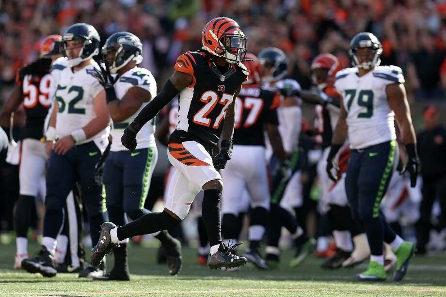 CINCINNATI, OH - OCTOBER 11:  Dre Kirkpatrick #27 of the Cincinnati Bengals celebrates after sacking Russell Wilson #3 of the Seattle Seahawks during overtime at Paul Brown Stadium on October 11, 2015 in Cincinnati, Ohio. Cincinnati defeated Seattle 27-24 in overtime. Photo: Andy Lyons, Getty Images / 2015 Getty Images