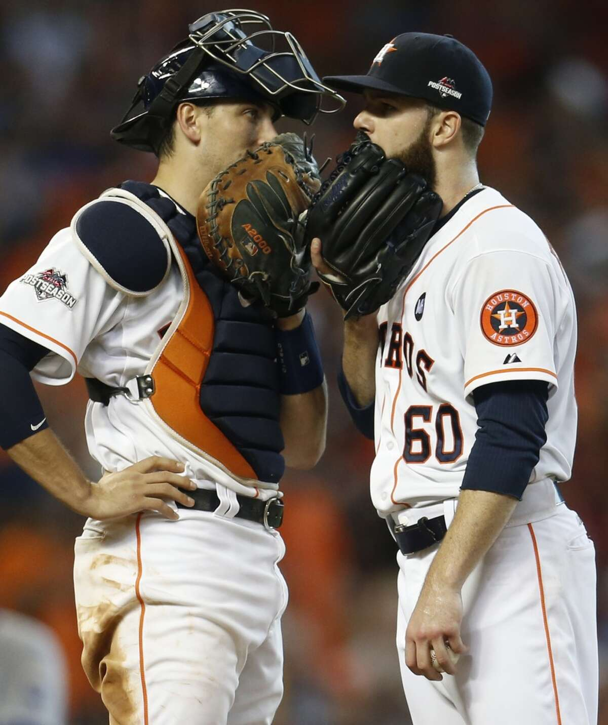 Houston Astros catcher Jason Castro (15) and starter Dallas Keuchel (60) talk on the mound during the seventh inning of Game 3 of the American League Division Series at Minute Maid Park on Sunday, Oct. 11, 2015, in Houston. ( Karen Warren / Houston Chronicle )